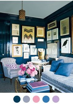 I love this Victorian style of hanging pictures so that all of the wall is taken up with art.