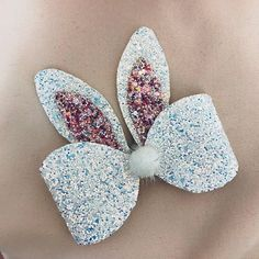Our beautiful Lacey hair bow has been blessed with some bunny ears perfect for this Easter. These inch bunny ears are placed onto our Lacey bow, will lots of chunky glitter. Our bunny ear bow comes on a metal crocodile clip. Making Hair Bows, Diy Hair Bows, Diy Bow, Unique Hair Bows, Handmade Hair Bows, Bow Template, Diy Accessoires, Diy Hair Accessories, Cricut Creations