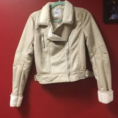 Jacket Tan, suade jacket. Never worn, tag still on it. Size large but fits like a small/medium. Just don't like how it looks on me. Jackets & Coats