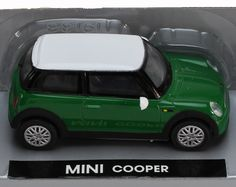 "Die-Cast Replica of the MINI Cooper.  1:43 Scale (3 1/4"").  Includes Stand for display.  Ages 5 and Up"