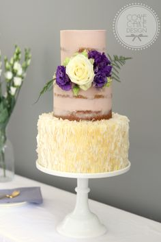 Semi-naked Earl Grey, Lemon and Lavender Cake with coconut ruffles and fresh flowers
