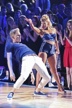 """Witney Carson & Cody Simpson   -  danced a jazz routine to Cody's :Surfboard""""  -   ABC's 'Dancing With The Stars'  -  week 3  -  season 18  -  March 31, 2014  -  scored 9+8+9+9=35 of 40 possible points.  guest judge was GMA's Robin Roberts."""