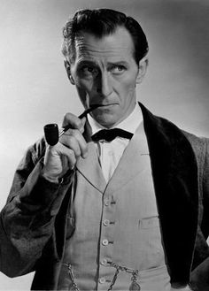 Peter Cushing as Holmes in The Hound of the Baskervilles (1959)