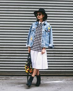 If your denim jacket is starting to feel tired, take a cue from this punchy ensemble and personalize it with buttons and pins. Layer away with oversized houndstooth and a statement bag for a look that's sure to turn heads.