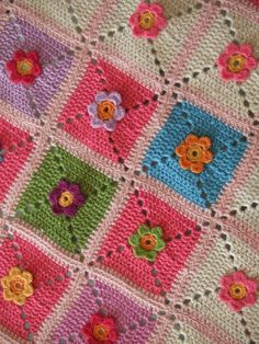 Such an adorable idea! Squares afghan with flower centers attached.