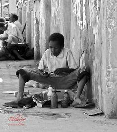 Shoe cleaner in some corner in Khartoum main market (Arabi market) - by   Mohamed Elshareif