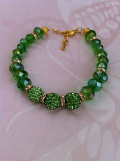 Gorgeous green crystal and shamballa style beaded necklace earrings and bracelet set via Etsy