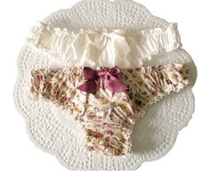 The Ruffle Thong is easy and quick to sew - AND is a great way to use up those cute, printed cotton scraps. This pattern uses only 1/2 yard of fabric plus a small piece of cotton jersey.    This is an easy pattern that requires basic knowledge of bias cuts, and how to ruffle using elastic.    For Detailed Instructions, including Photos - visit http://ohhhlulu.blogspot.ca/2012/07/RuffleThongHowTo.html    Five sizes are included in this PDF, print-at-home pattern  ...