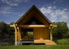 A picturesque lake is the setting for this fisherman's hut by Niall McLaughlin Architects, which can be opened up in summer and battened down in winter