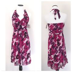 JONATHAN MARTIN Floral Halter Dress Size:  16 Color:  Purple and Pink Material:  100% Polyester Lining:  100% Polyester Closure:  Hidden Side Zipper Details:  NWT, Ruffled Hem and Neckline, Halter Care:  Machine Wash  All measurements are taken with garment laying flat and not doubled:  Bust:  19 1/2 inches Waist:  17 inches Underarm to Hem:  30 1/2 inches Jonathan Martin Dresses