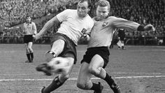Uwe Seeler (Hamburger SV, 1953–1972, 476 apps, 404 goals) in a duel with Klaus-Dieter Sieloff (VfB Stuttgart, 1960–1969, 174 apps, 22 goals).