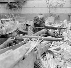 Lance Corporal R. Hearn and Private F. Slater (nearest camera) of the Royal Norfolk Regiment, Division, aim their weapons in the ruins of Kervenheim, 3 March Corporal Hearn is using a captured German 'Schmeisser' submachine gun. British Army Uniform, British Soldier, Military Photos, Military History, Ww2 History, Lance Corporal, British Armed Forces, Germany Ww2, Army Infantry