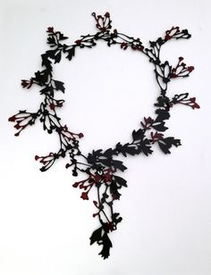 Necklace | Helen Shirk.  Mild steel, china paint, patina