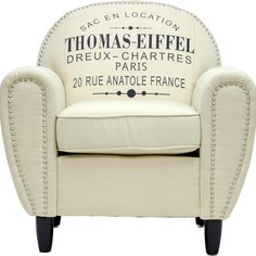Bold typography and classic nailhead trim define this birch wood-framed arm chair, a striking addition to your living room or den seating group.