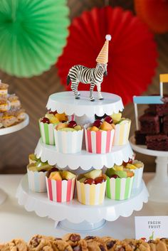 Vintage Circus Birthday Party styled by The TomKat Studio | Fill these adorable paper cups with fruit or other snacks to add a fun, colorful touch to your party! See the full party, ideas + free printables here: http://www.thetomkatstudio.com/vintage-circus-birthday-party/