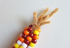 Sewing Ideas For Kids Pony Bead Indian Corn - Fun and easy Thanksgiving craft for the kids! - Make this Pony Bead Indian Corn - A fun and easy Thanksgiving craft for the kids! All you need is some pipe cleaner and pony beads! Toddler Crafts, Preschool Crafts, Fun Crafts, Daycare Crafts, Thanksgiving Crafts For Kids, Holiday Crafts, Thanksgiving Decorations, Autumn Decorations, Autumn Crafts