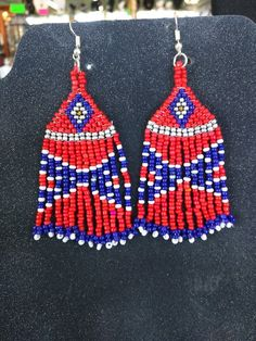 13bd4d091ae These are 2 long Chandler earring. Made with Seed beads in the pattern of  the Rebel Flag.