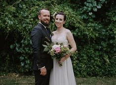 Lovely dress and bouquet. Colleen Riley Photography.