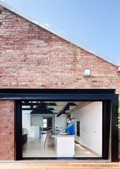 Andrew Simpson Architects has converted a red brick warehouse in Melbourne into a loft-style residence, with separate entrances for different members of the resident family