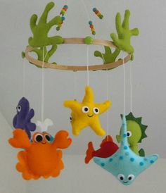 To decorate and amuse your baby, here is the baby mobile Under the sea! Good idea for a birth gift. This is an example, yours is gonna be made specially for you! Dont wash, just clean with an humid towel without rubber. This is not a toy! Sweetfelt mobiles are for room decoration only!