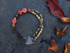 Female shaman with a bow  rock art bracelet by solekoru on Etsy