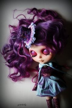 Delicate #Blythe #doll with long #Purple hair and a top hat.