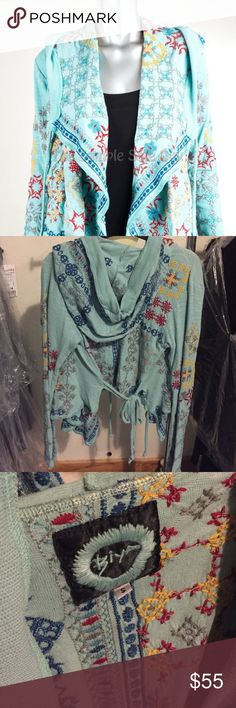 "Light Blue Embroidered Crop Hoodie Johnny Was The BIYA IMILIST SHORT HOODED wrap jacket features colorful detailed embroidery designs inspired by Folk Art throughout with an open draped front and waist tie detail BUST 38"" LENGTH 25"" front 17"" back Johnny Was Sweaters Cardigans"
