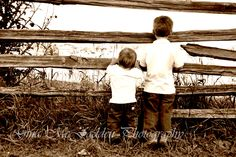 I shot this photo of these two little brothers checking for cows in the field.