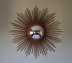An original mid century modern gilt metal sunburst convex mirror, stamped Chaty…