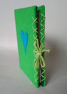 Multiple signature Eco-felt wrapped book with braided hemp  ties.