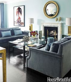 I really like the clean lines of the sofa, especially the arms.   House Beautiful