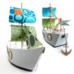 Step by step photo tutorial and free hull template for making this Cardboard Pirate Ship