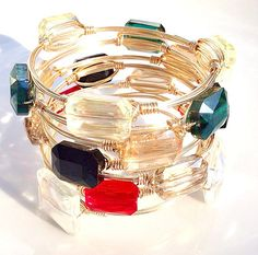 The Summer Crush is a crystal stone gold wire wrap bauble bangle bracelet with a GORGEOUS aurora borealis finish! Shimmers at every angle in the