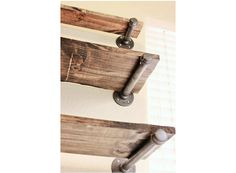 Industrial Shelving, Cupboard or Bookshelf - Set of 3    Shelves are made from industrial pipe and rustic wood. Shelving and can be used in a