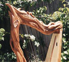 Celtic Harp, Custom 34 nylon strings, Cherry Wood, with nylon strings. Carved 'Oak Tree' harp, with 38 nylon strings.