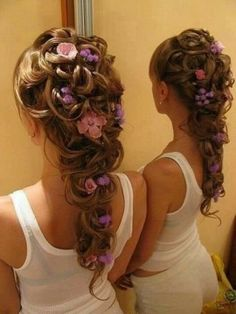 White orchids would look better in this intricate hair style.  Out door weddings can be breezy so best for an indoor ceremony