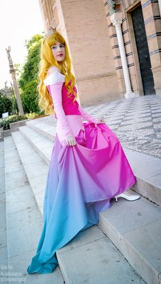 Aurora Cosplay  Love the blue and pink on dress, makes it look like it is changing colors. Don't like the hair though