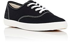 She has been wanting a pair of black and white shoes.  9 Narrow is her size.  Keds Made In The USA Champion Sneakers
