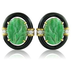 Remarkable David Webb 18K gold and platinum earrings featuring stunning carved jade with a black enamel halo. Earrings are decorated with approximately 0.30ctw of diamonds. Come with original David We