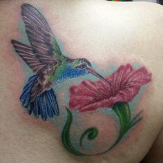 green/blue hummingbird tattoo