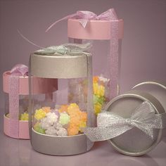 Plastic Cylinder Container With Paper Caps & Metallic Ribbon $34.73 for 48 in smallest size