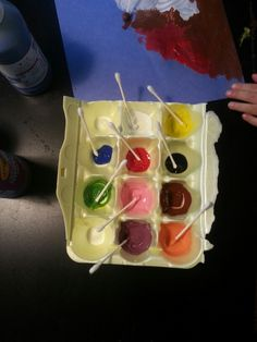 Qtips and an empty egg carton for painting with small children. Washable paints