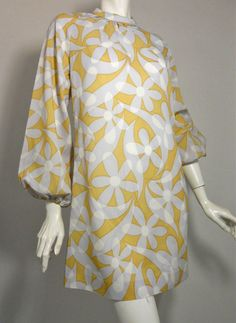 1960s lightweight crepe rayon mini dress in pale golden yellow with mod daisies in soft blue and white.  $165