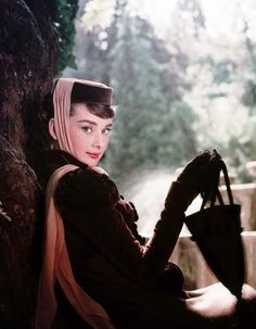 Audrey Hepburn with umbrella and head scarf beautiful!