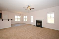 The Biltmore living room with gas fireplace. Built by Mckee Homes.