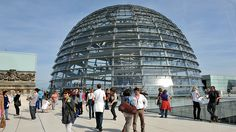 Photo: visitors walking around the dome of the Reichtags Building and reading information boards