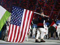 USA flag bearer Julie Chu during the closing ceremony.