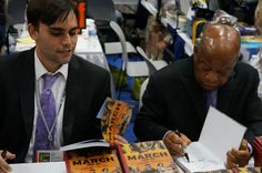 Andrew Aydin, @repjohnlewis take turns adding their John Hancock's to #MARCH books #SDCC