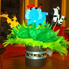Baby shower centerpieces  @Linda Merrill (the animals are less than a $1 at Hobby Lobby)