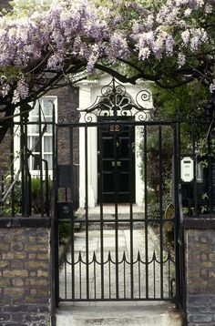 Georgian Elegance, Georgian-style wrought-iron gates will create an effortlessly elegant entrance to your home; for similar styles try Lassco. Photo courtesy of Robert O'Dea / Red Cover